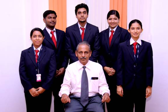Dr. Rajan Varughese, Director / Principal of MCMAT with the winners of First Prize in All Kerala Management Association (KMA).